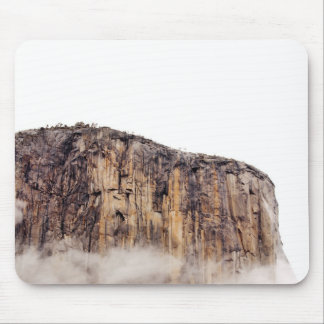 Sheer cliff rising above clouds mouse mat