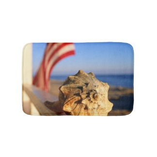 Shell On Porch Railing With American Flag Bath Mats