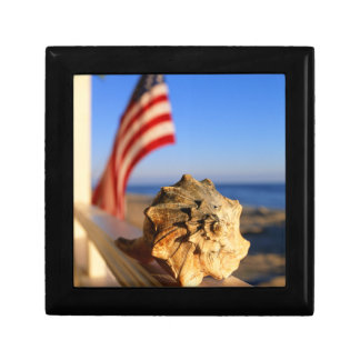 Shell On Porch Railing With American Flag Gift Box