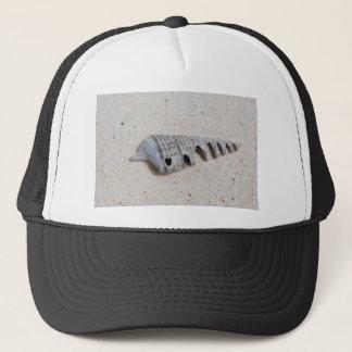 Shell on white sandy beach trucker hat
