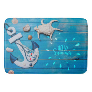 Shells and anchor on blue wooden surface Bath Mat