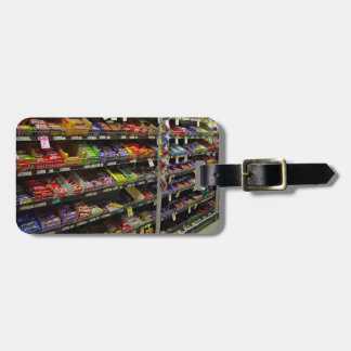 Shelves of chocolate bars in store luggage tag
