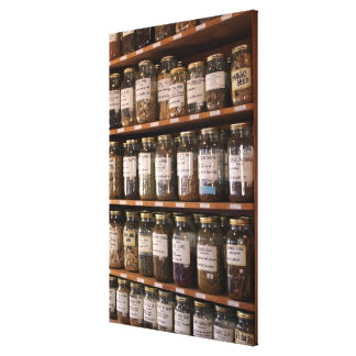Shelves of herb jars canvas print