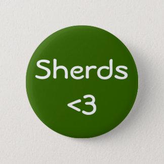 Sherds <3 6 cm round badge