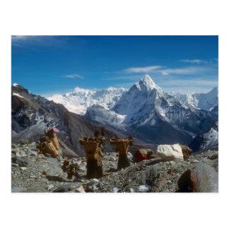 Sherpanis carrying climbing loads postcard