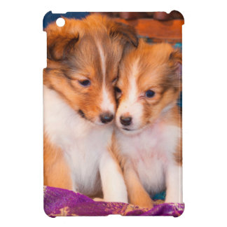 Shetland Sheepdog puppies sitting by wooden wagon iPad Mini Covers