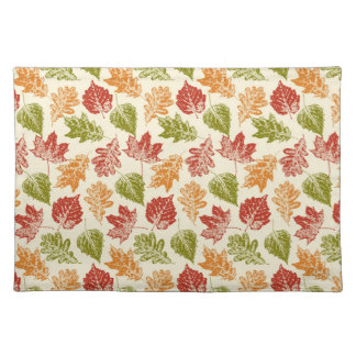 Shiny autumn atmosphere with fall leaves on cream placemat