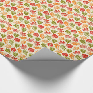 Shiny autumn atmosphere with fall leaves on cream wrapping paper