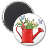 Shiny Red Watering Can with Yellow Tulips