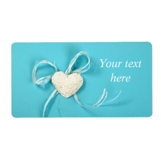 Shipping label with heart on pastel blue paper