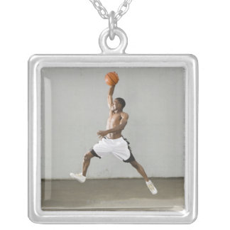 shirtless man jumping with a basketball silver plated necklace