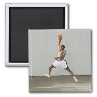 shirtless man jumping with a basketball square magnet