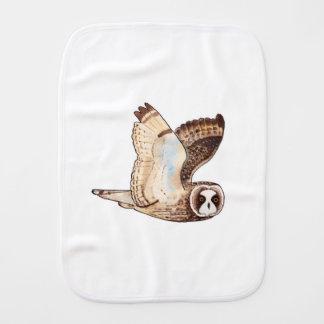 Short eared owl flying by burp cloth
