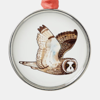 Short eared owl flying by christmas ornament