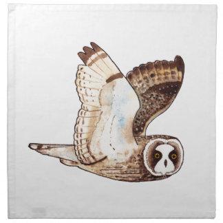 Short eared owl flying by napkin