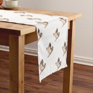 Short eared owl flying by short table runner
