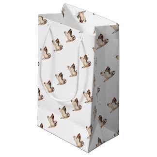 Short eared owl flying by small gift bag
