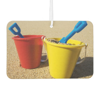 Shovels And Pails On Sandy Beach