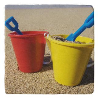 Shovels And Pails On Sandy Beach Trivet