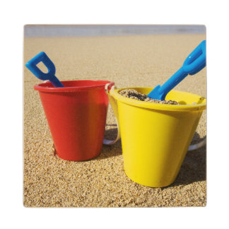 Shovels And Pails On Sandy Beach Wood Coaster