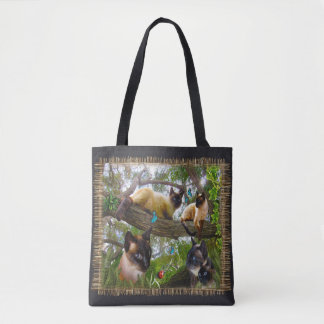Siamese Sophie playing in her garden Tote Bag