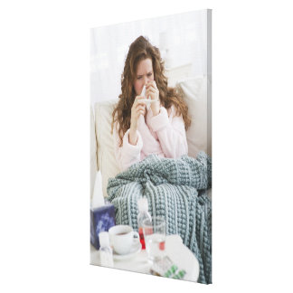 Sick woman on couch canvas prints