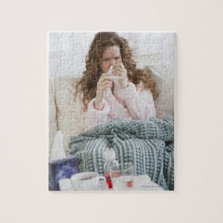 Sick woman on couch jigsaw puzzle