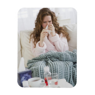 Sick woman on couch rectangular photo magnet