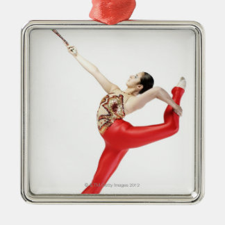 Side profile of a female gymnast practicing christmas ornament