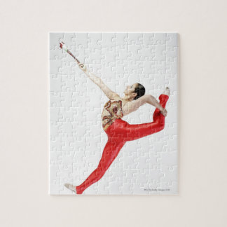 Side profile of a female gymnast practicing jigsaw puzzle