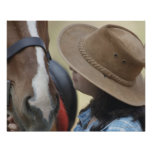 Side profile of a teenage girl touching a horse poster