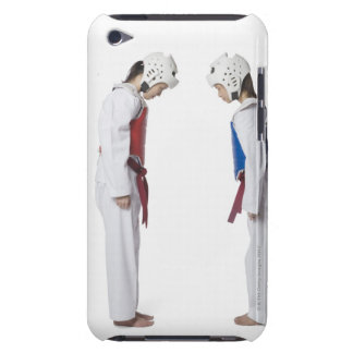 Side profile of two taekwondo players bowing barely there iPod cases