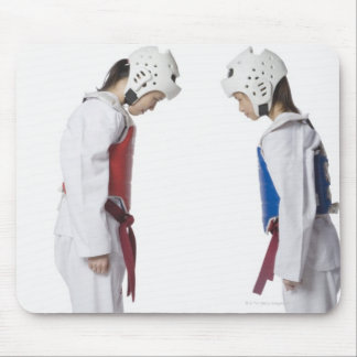 Side profile of two taekwondo players bowing mouse mat