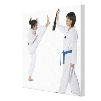 Side profile of two young women practicing canvas print