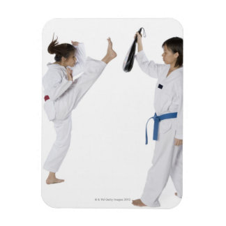 Side profile of two young women practicing rectangular photo magnet
