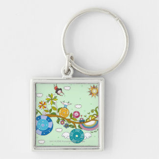 Side view of children playing on tree branch key ring