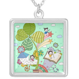 Side view of children studying by potted plant silver plated necklace