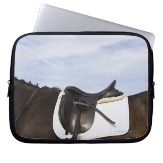 side view of saddled horse laptop sleeve
