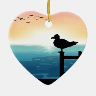 Sihouette bird at sea ceramic heart decoration