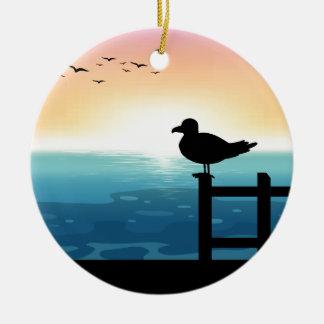 Sihouette bird at sea round ceramic decoration