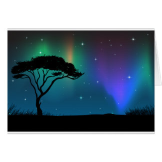 Silhouette field with aurora sky at night greeting card
