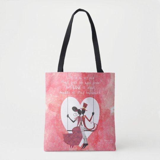 Silhouette lovers on a seesaw tote bag