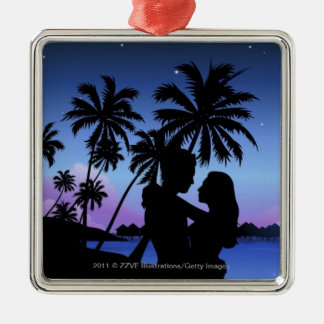Silhouette of a couple embracing on the beach christmas ornament