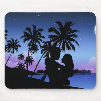 Silhouette of a couple embracing on the beach mouse pad