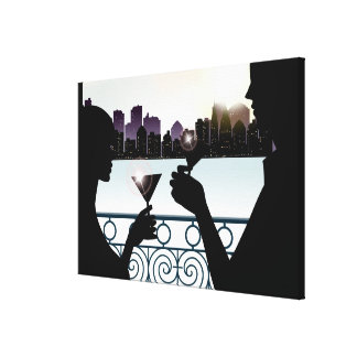 Silhouette of a couple toasting martini glasses canvas print