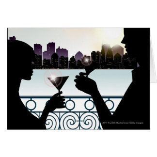 Silhouette of a couple toasting martini glasses card