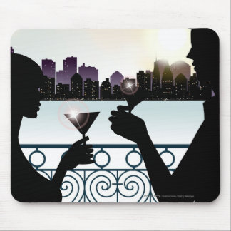 Silhouette of a couple toasting martini glasses mouse mat