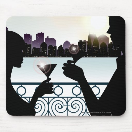 Silhouette of a couple toasting martini glasses mouse pads