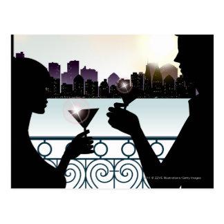 Silhouette of a couple toasting martini glasses postcard