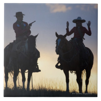Silhouette of a Cowboy targeting his pistol to a Large Square Tile